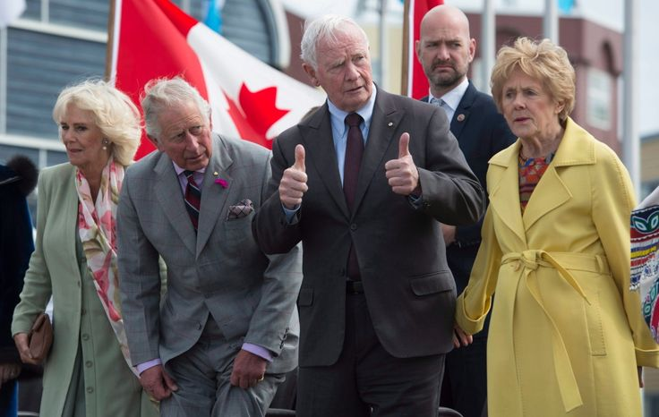 Governor General David Johnston gives the thumbs up as before sitting down with Prince Charles, Camilla and Sharon Johnston at the start of the official welcome in Iqaluit, Nunavut, Thursday, June 29, 2017. THE CANADIAN PRESS/Adrian Wyld