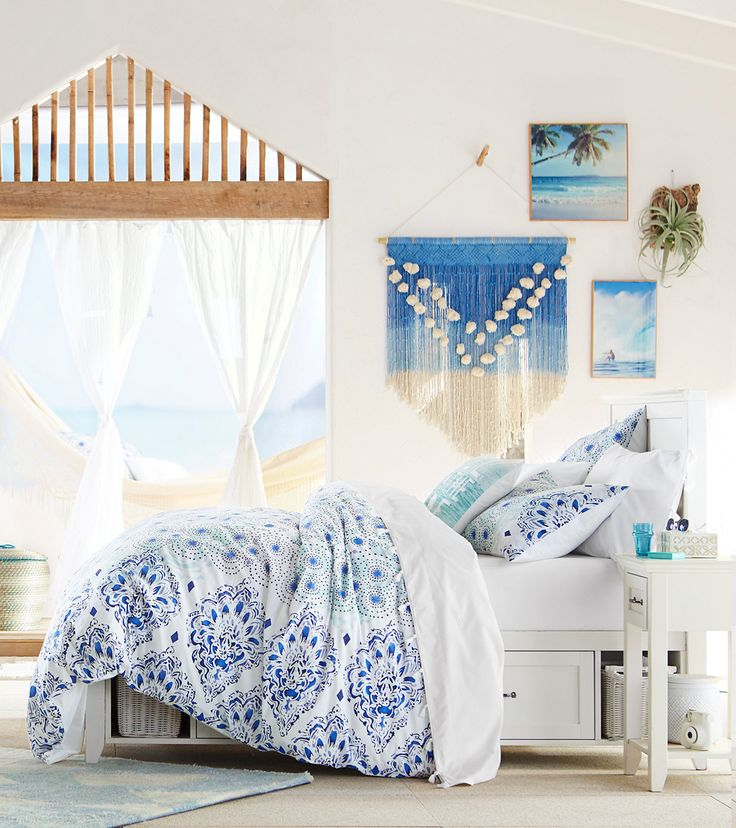 3 easy ways to get the surfer look in your room: 1. Pick a breezy blue duvet 2. Add photos of the beach 3. Decorate with a macrame wall hanging.