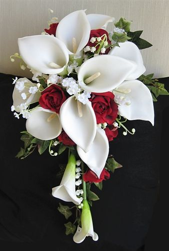 Off white calla lilies and red roses accents cascade