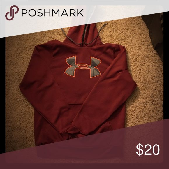 Under Armour Hoodie Burgandy Under Armour Hoodie with gray emblem outlined in orange. Never worn but no tags. Under Armour is written on the hood in orange as well. Under Armour Shirts Sweatshirts & Hoodies