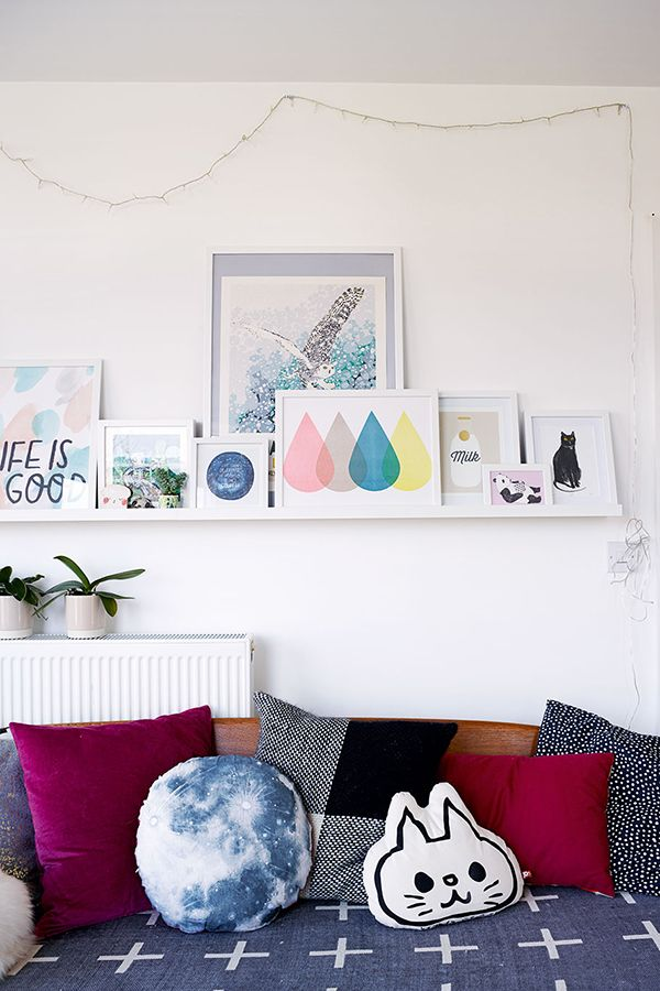 Print collection on a floating shelf - nice way to display all the prints!