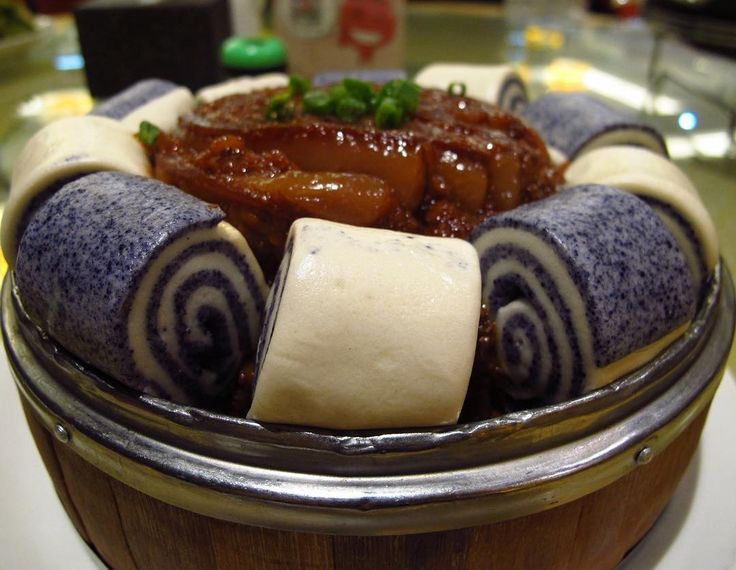 """Záliáng fěn zhēng ròu (杂粮粉蒸肉), a version of fěn zhēng ròu (#粉蒸肉) or """"flour steamed pork"""" consisting of spiced #pork steamed with a coating of #flour for a thick, multi-textured sauce at Shùntiān Restaurant (顺天食府) in Beijing (北京), China. The name means """"assorted grain"""" #fenzhengrou. The """"assorted grain"""" refers to flour made from red rice (红曲米), millet (小米), corn (玉米), buckwheat (荞麦) and red beans (红豆), resulting in a deeper color than the usual #riceflour. The dish is surrounded by dual-color…"""