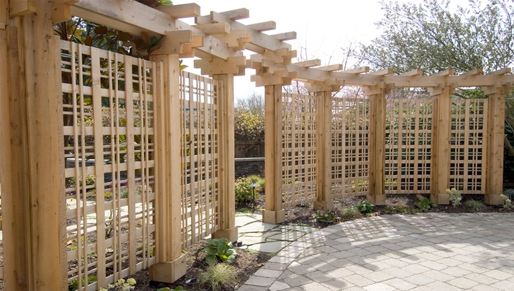 This wooden fence arbor does an effective job of screening without making the garden feel closed-in or dark. Design by Fine Construction in WA.