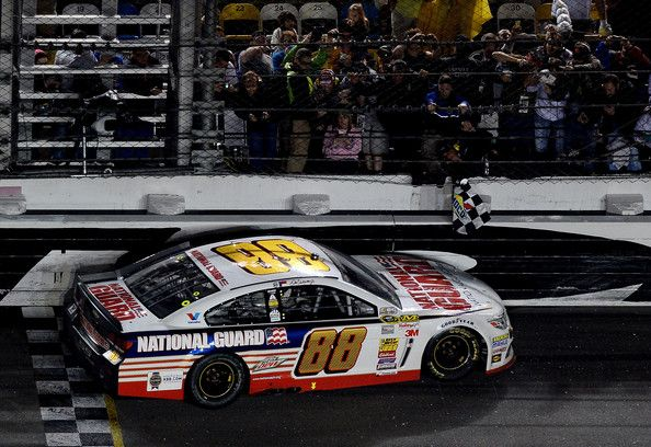 Dale Earnhardt Jr., driver of the #88 National Guard Chevrolet, celebrates with the checkered flag after winning the NASCAR Sprint Cup Series Daytona 500 at Daytona International Speedway on February 23, 2014 in Daytona Beach, Florida. http://www.pinterest.com/jr88rules/nascar-2014/ #DaleJr2014