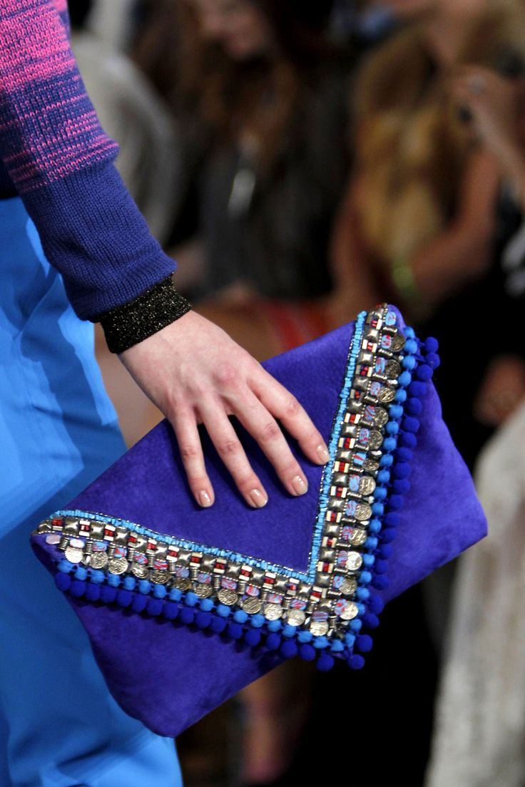You couldn't miss this embellished envelope clutch on the Matthew Williamson catwalk