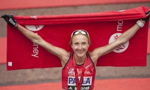 Her shirt marked only with 'Paula', Paula Radcliffe celebrates after finishing the London Marathon on Sunday.