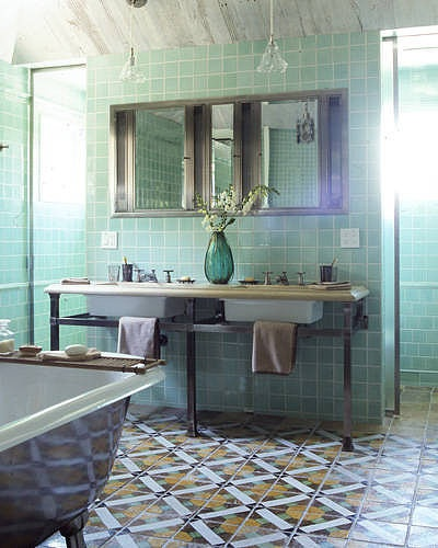 10+ Green Rooms That Will Inspire Envy: Keeping with the style of the 19th-century antique floor tiles, mint-green tiles on the walls have a relaxing effect without sacrificing color or character.   Source: Elle Decor