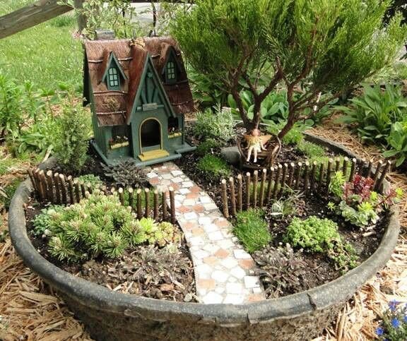 Fairy Houses for the Garden | Fairy garden. Pot mostly set into the ground. | My house (or things I ...
