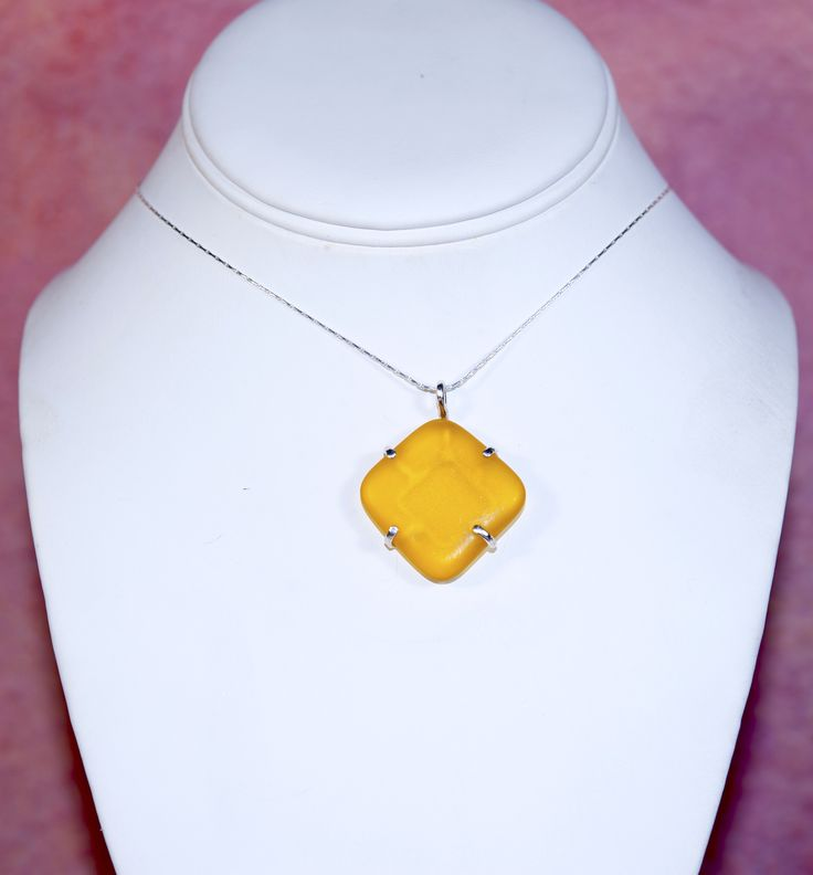 A Personal Favorite... Yellow Sea Glass in a 4 prong Sterling Silver setting. It's like wearing Sunshine on a Chain