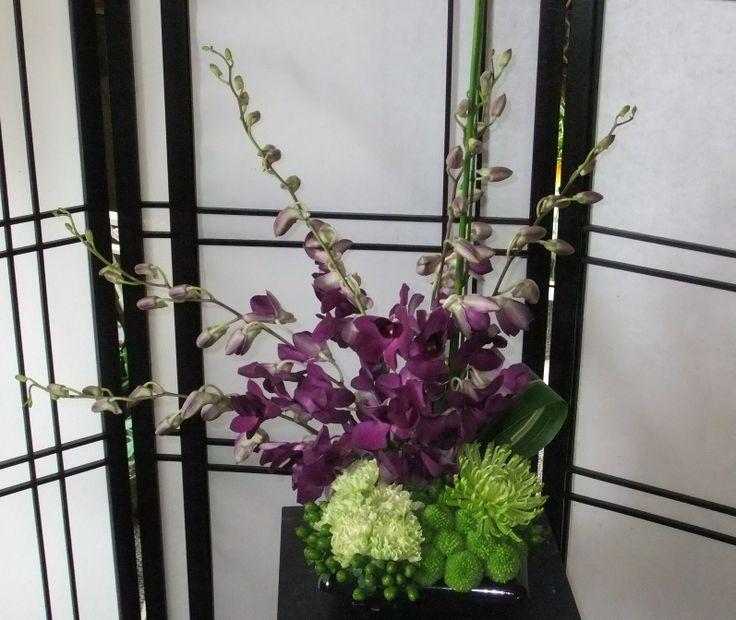 Spray Zen-zen purple dendros, green carns, hypercium berries, fugis, kermits & aspidistra leaves