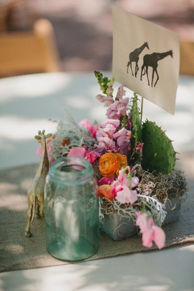 I like the silhouette of the animals for the table cards. But I would add a doleful trim to make it more elegant.