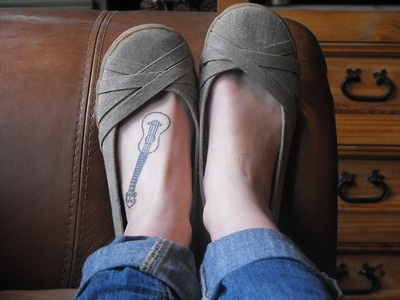 ukulele tattoo.  Its so pretty :D