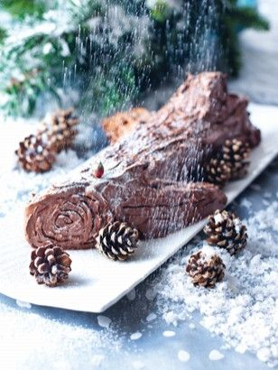 YULE LOG | Recipes | Nigella Lawson  I made this three times in December and it is one of the most delicious chocolate cakes I've ever made - or eaten! Rolling the cake is a challenge and instead I cut it into thirds and stacked the layers with frosting in between. Not exactly loggish but close enough! Tuck in a few parsley sprigs and voila - festive! :)