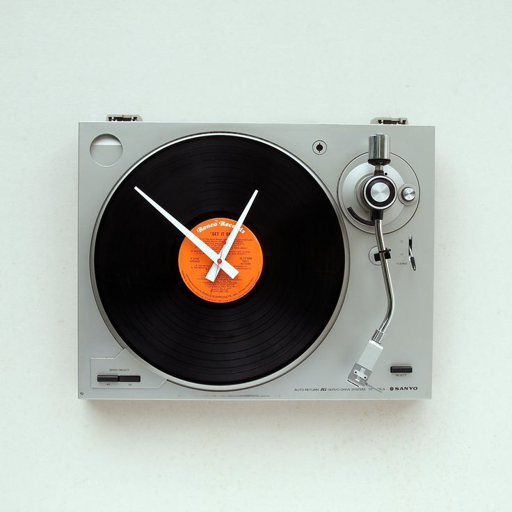 Clock made from a recycled Sanyo  turntable. $119.00, via Etsy.