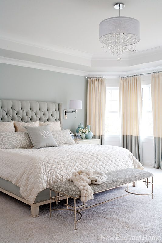 Love this! A modern and glamorous Greenwich home with a beautiful master bedroom. A chandelier, upholstered headboard, wall sconces and nightstands in white, blue and silver are always chic.: