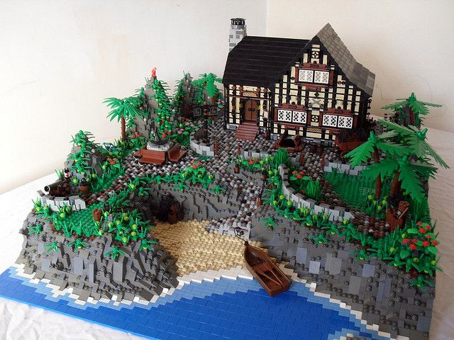 The Tavern by Derfel Cadarn.  The cobblestones are excellent.  The rocky cliffs are too.  The trees and greenery placed here n there shows Derfel's great artistic talents for balance.  Gorgeous MOC.