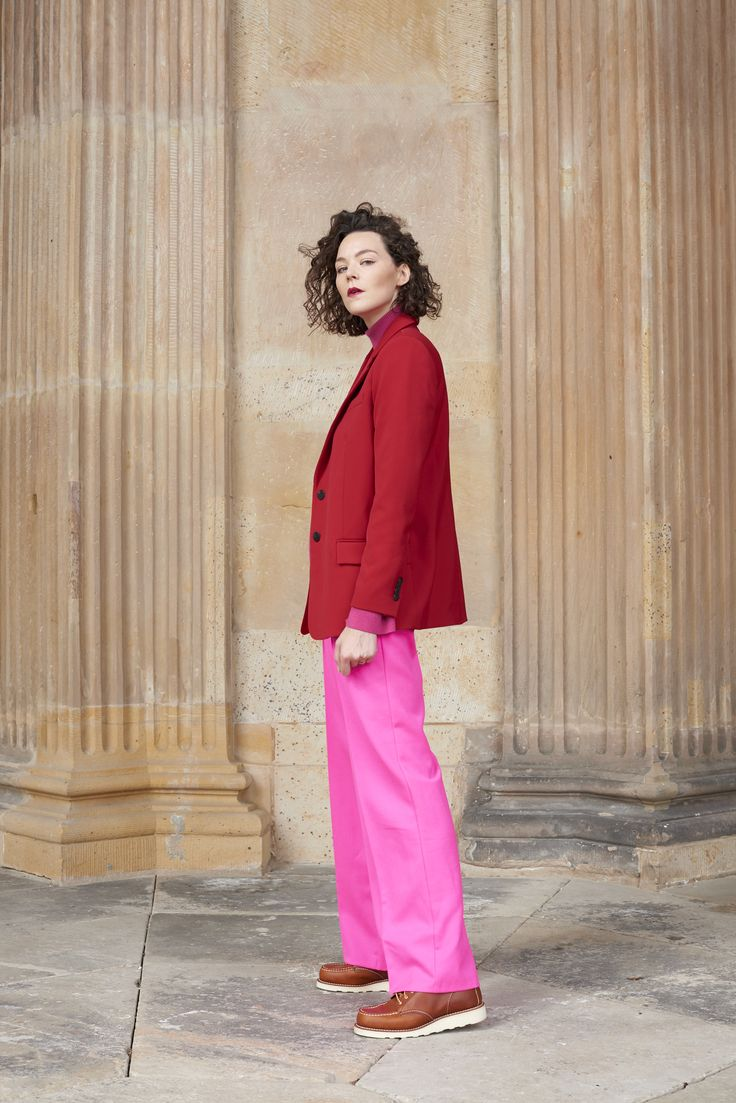 Kiki Albrecht is wearing Red Wing Moc Toe boots, Mango blazer, Malaikaraiss wool pants and a Tiger Of Sweden sweater