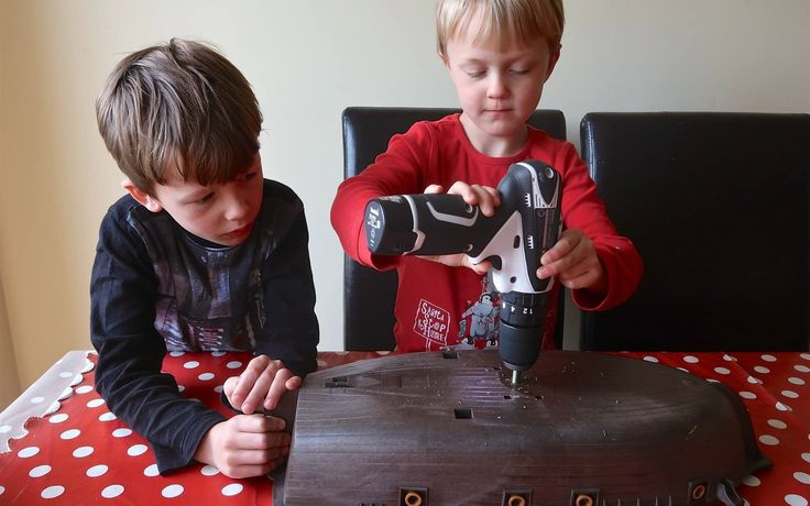 Brothers' delight at their Playmobil pirate ship sailing to Scandinavia