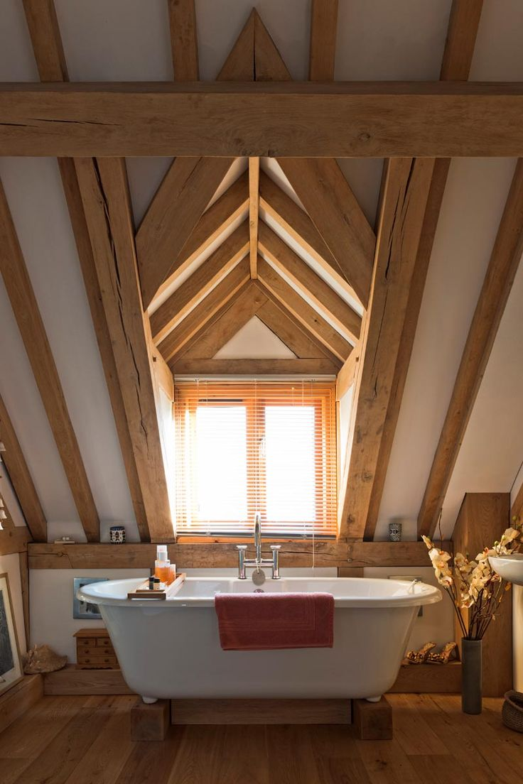 A beautiful room to relax and unwind surrounded by oak frame. Oak frame can completely transform a bathroom giving it wonderful character and a cosy feel. www.welshoakframe.com #bathroomideas #oakframe #freestandingbath #oakframebathroom