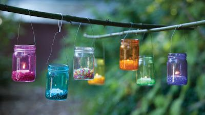 Apply Adirondack Alcohol Ink and wrap wire around a mason jar filled with acrylic filler (gems) and a tealight (or LED) to create lanterns.