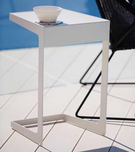 Swap out your traditional coffee table for BOXHILL's innovative Time-Out Side Table! Practical and functional this table brings everything a little closer as it slides over your lounge chair or sofa. See our complete collection of attractive outdoor accessories at www.shopboxhill.com
