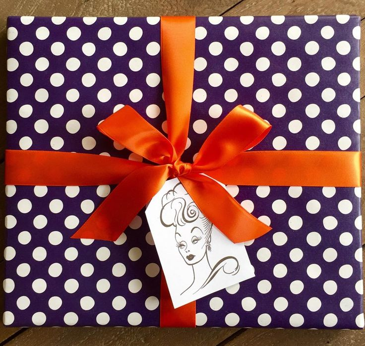 Gift Wrap to the stars. A Lucille Ball gift wrap featuring 50's polka dots wrap, orange ribbon and a fabulous I Love Lucy tag.