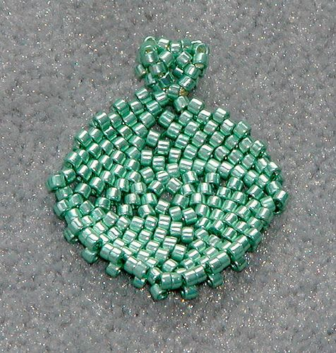Peyote square. This has a nice curvature, is nearly flat - this is an example of off-set increases in flat circular peyote weave with a 4-bead center
