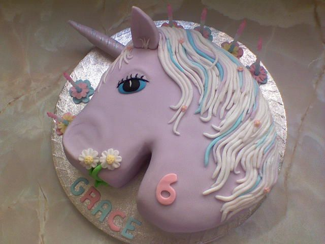 unicorn - sponge cake filled with jam and buttercream.  hand sculpted  and covered with fondant icing!