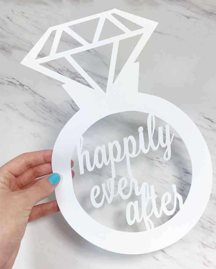 Happily Ever After wedding sign made of paper - cute idea for engagement party decorations. It would be fun to hang several of these from the ceiling :)