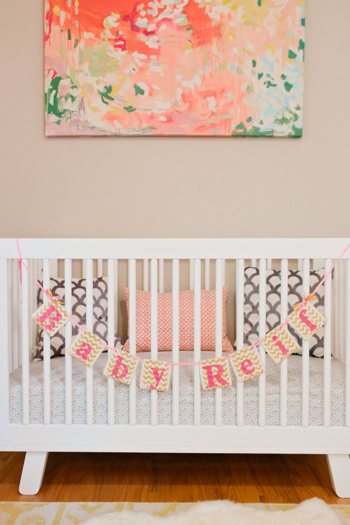Beautiful modern pink and gold nursery - we love the crib banner! (Remove for safety once baby arrives and is in crib)