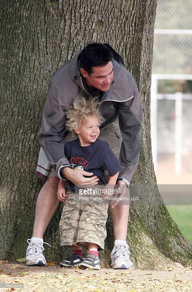 Los Angeles, California, December 13, 2008 DEAN CAIN gives a lift to a little boy celebrating his son's flag football team's win at a Los Angeles park. The ex-star of the Superman series, was once signed by The Buffalo Bills, but a knee injury cut his pro carreer short. He now channels his love for football by coaching his son's team. PGcp6