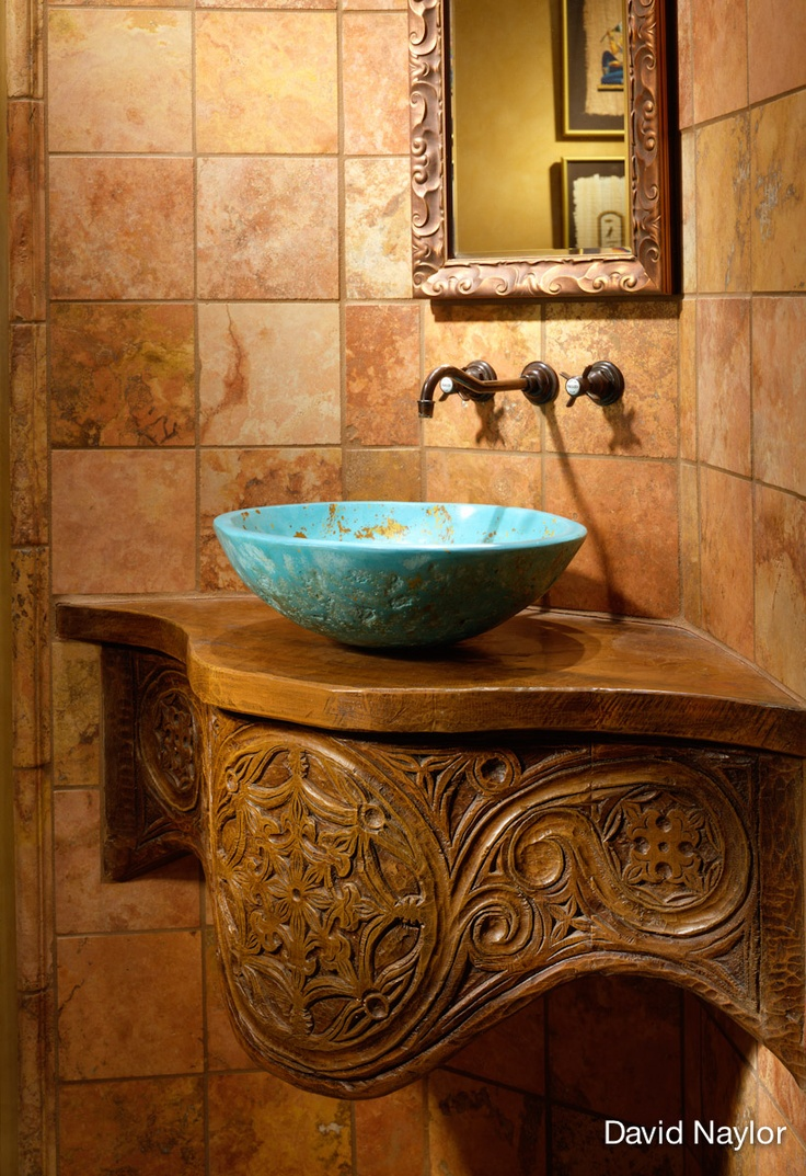 David Naylor Interiors, Santa Fe, stunning turquoise copper bowl sink; the stone tile is Italian travertine.