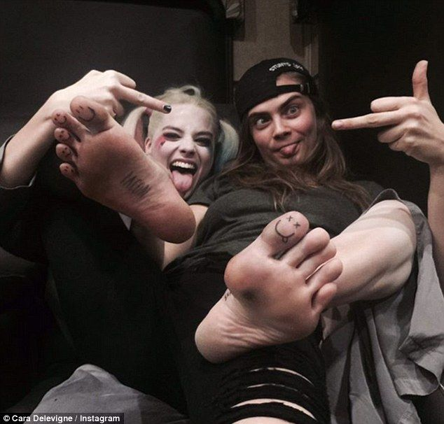 'Toemoji time': Cara even took to Instagram to show off her unique friendship with Margot as they drew emojis on their feet