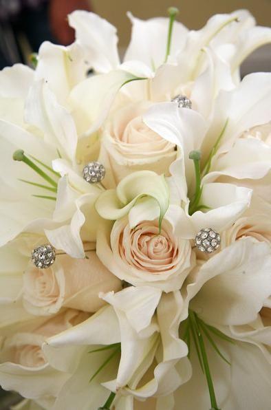 White Roses with Casablanca Lilies reception wedding flowers,  wedding decor, wedding flower centerpiece, wedding flower arrangement, add pic source on comment and we will update it. www.myfloweraffair.com can create this beautiful wedding flower look.