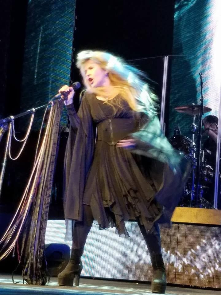 a spectacular photo of Stevie   ~ ☆♥❤♥☆ ~   onstage recently where everything seems to be flying except her boots which are firmly planted wide apart, almost in her signature 'Stevie Crouch'