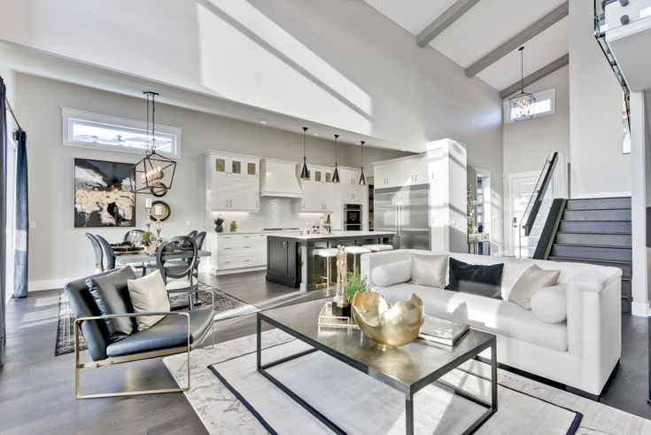 Open concept living space keeps things airy! We just love the crisp white with black and gold touches.
