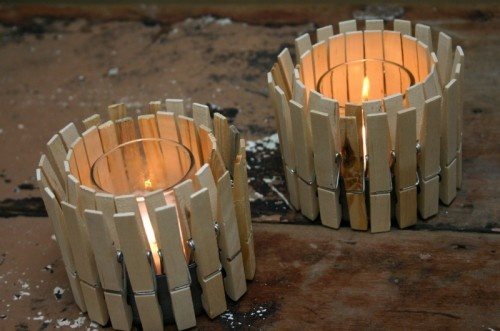 Clothespin candle holder. A Tuna can with clothespins clipped and a galss votive holder in the middle.