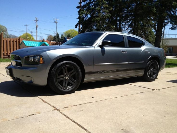 My 2006 Dodge Charger with gunmetal grey powder coated rims and 20% window tint