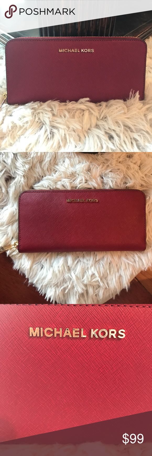 NWT Michael Kors Jet Set Travel Wallet Brand new with tags Michael Kors Jet Set Travel Continental Wallet. Color is cherry 🍒 Michael Kors Bags Wallets