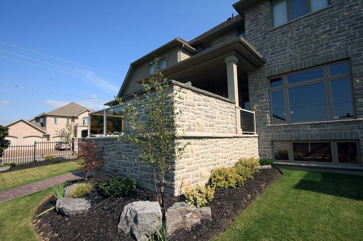 This is a very nicely designed and built composite deck in Kitchener with some great stone work and an outdoor BBQ area.