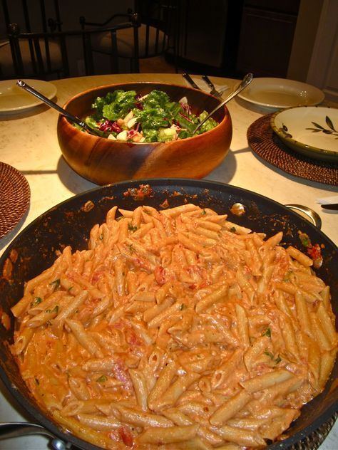 Penne alla Vodka: I used light cream, red onions instead of white, added 1 cup of chicken broth and melted 1/8 cup of parmesan cheese into the sauce and it was delicious.