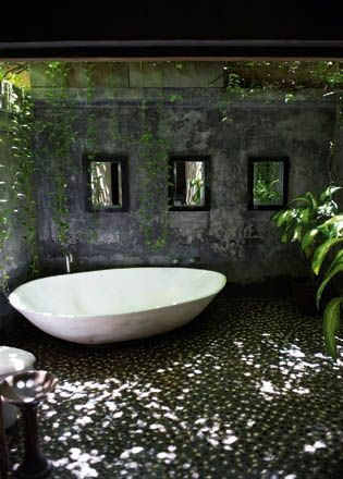 Outdoor bath, im crying over this. the shape of the tub and the shadows and pebbles and trees............