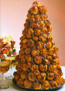 Croquembouche - traditional French wedding cake made from Profiteroles filled with custard, drizzled with caramel, and topped with spun sugar.