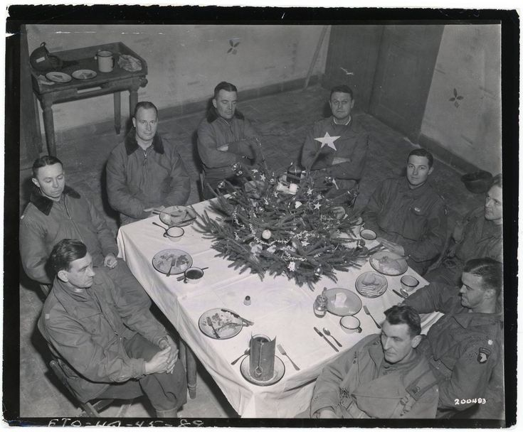 """Brig. Gen. Anthony McAuliffe and his staff gathered inside Bastogne's Heintz Barracks for Christmas dinner Dec. 25th, 1944. This military barracks served as the Division Main Command Post during the siege of Bastogne, Belgium during WWII. The facility is now a museum known as the """"Nuts Cave"""". Photo Credit: U.S. Army."""