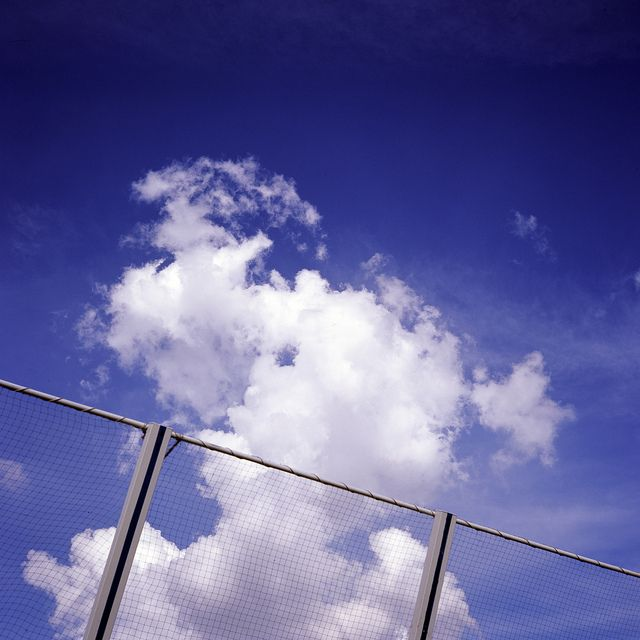 blue sky over the fence