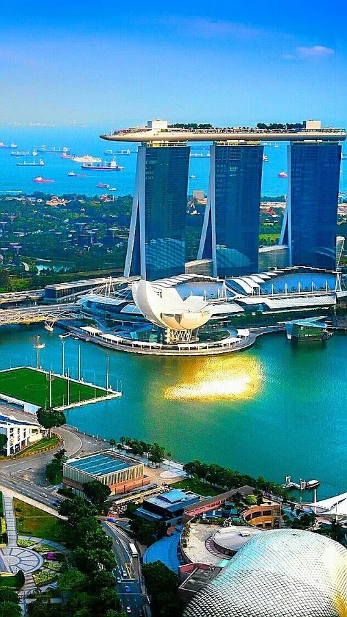 Marina Bay Sands, Singapore. A platform held up by 3 skyscrapers creates the appearance of an island in the sky.