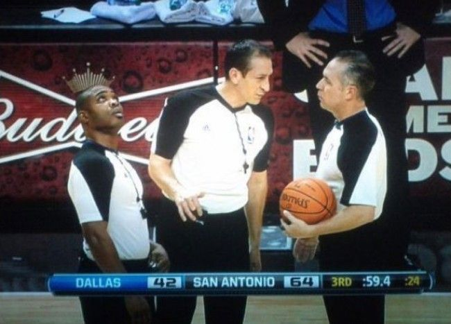 Referee wearing budweiser crown perfectly timed photo