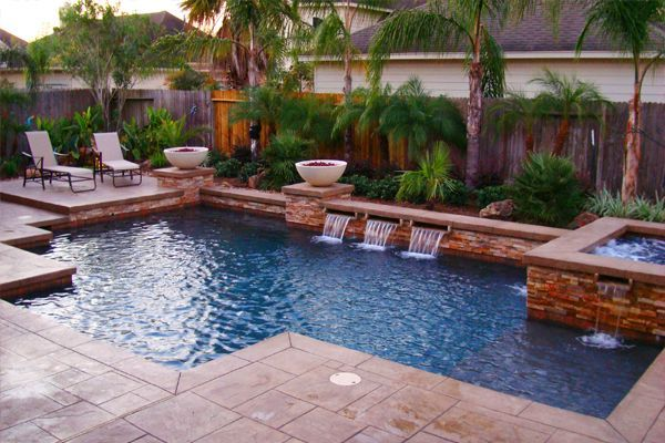 Firepits and hot tub with waterfall.  Looks refreshing!  #pools #pooldesigns homechanneltv.com