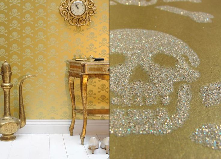Skull Gold Glitter Wallpaper inspiration as backdrop.  My version – black fabric for the accent wall, skull stencil outline (just print one out), adhesive glue and break a glow stick (come in different colors!) and mix in with some glitter…repeat…