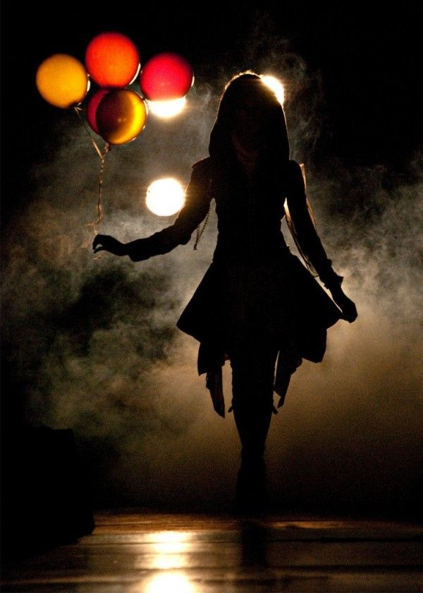 silhouette with balloons